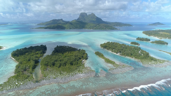Bora Bora, aerial view of the lagoon and barrier reef, 4K UHD