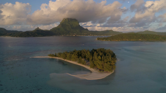 Bora Bora, aerial view of the sunset on the island, 4K UHD