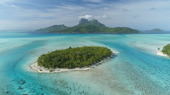 Bora Bora, aerial view of the island and islet in the lagoon, 4K UHD