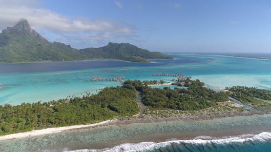 Bora Bora, aerial view of the island and luxury overwater hotels, 4K UHD