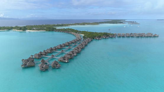 Bora Bora island, aerial view of a luxury hotel in the lagoon, 4K UHD