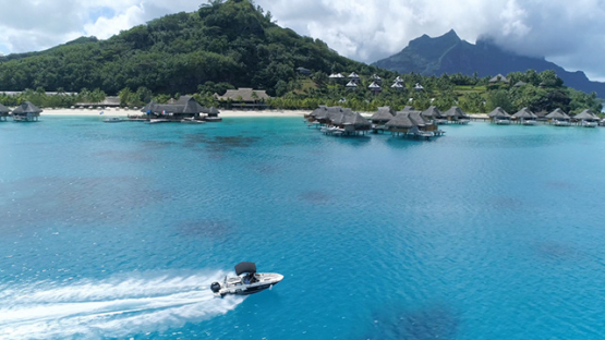 Bora Bora, aerial view of the island and luxury hotel, 4K UHD