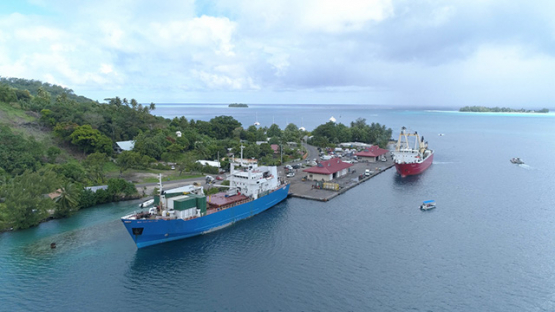 Bora Bora, aerial view of two cargo ships docked in Faanui bay, 4K UHD