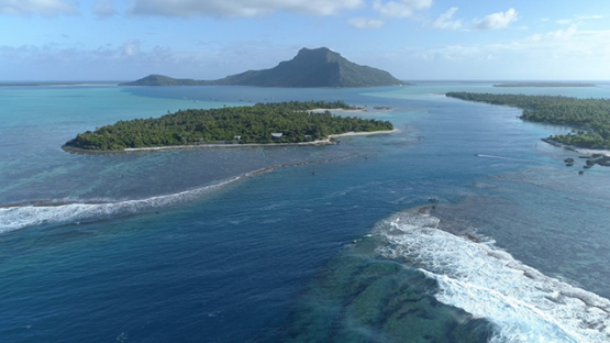 Maupiti, aerial view of the pass Onoiau and the island, 4K UHD