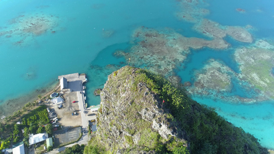 Maupiti, aerial view at the top of Teurafaatiu mountain above the docks, 4K UHD