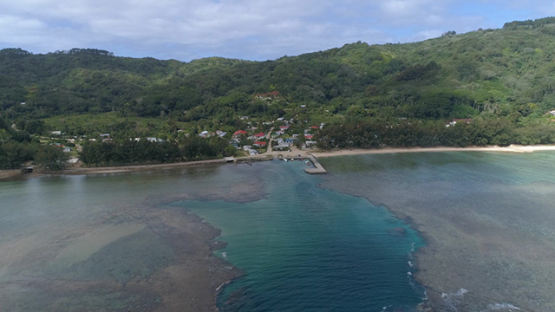 Rurutu, aerial view of the island and village Avera, 4K UHD