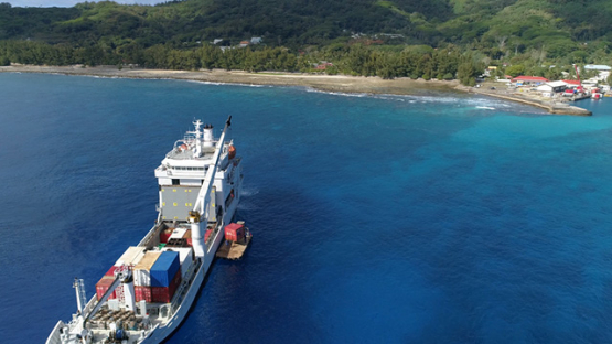 Rurutu, aerial view of a cargo ship in the bay Moerai, 4K UHD