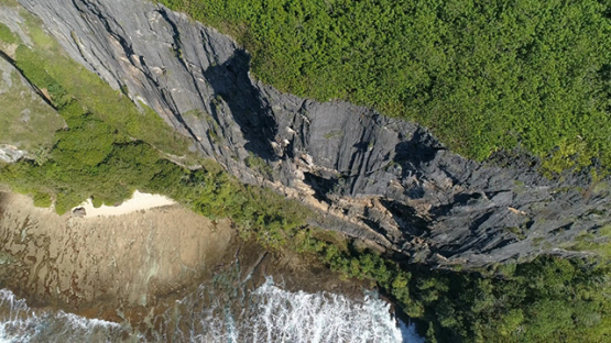 Rurutu, aerial view above the cliffs of Toarepe, 4K UHD
