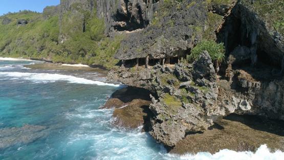 Rurutu, aerial view of the cliff of Toarutu, 4K UHD