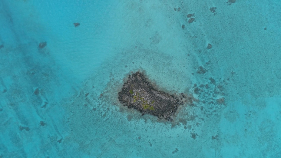 Tubuai, aerial view of the rocky islet Ofai in the lagoon, 4K UHD
