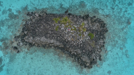 Tubuai, aerial view above the rocky islet Ofai in the lagoon, 4K UHD