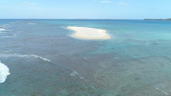 Tubuai, aerial view of the islet Motu Ono, 4K UHD