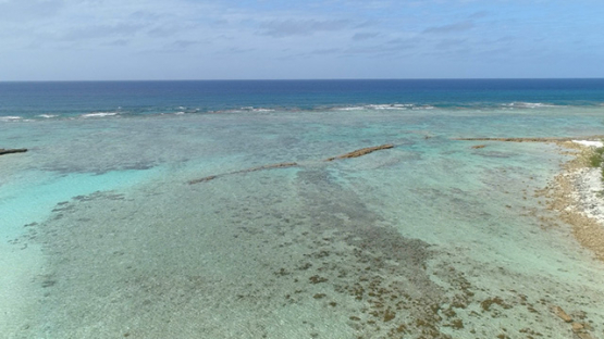 Tubuai, aerial view of the islet Motu Roa and the barrier reef, 4K UHD