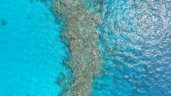 Tubuai, aerial view above the lagoon and coral reef, 4K UHD