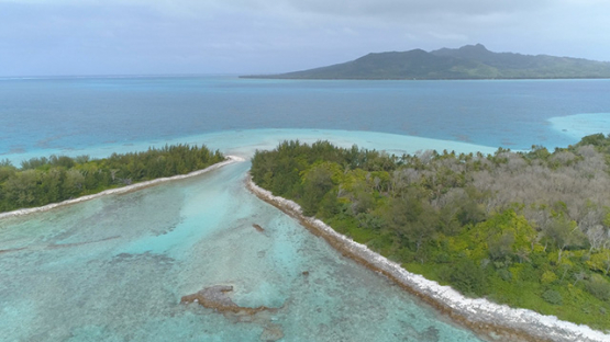 Tubuai, aerial view of the islet Motu Roa behind the barrier reef, 4K UHD