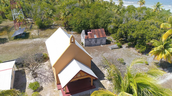 Fakarava, aerial view of the church of the village Tetamanu, 4K UHD