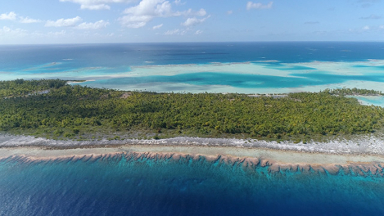 Fakarava, aerial view of the green lagoon and barrier reef, 4K UHD