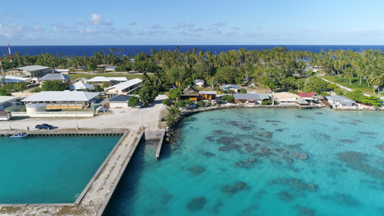 Fakarava, aerial view of the dock in the village Rotoava, 4K UHD