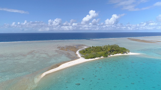 Fakarava, aerial view of tiny islet near the barrier reef, 4K UHD