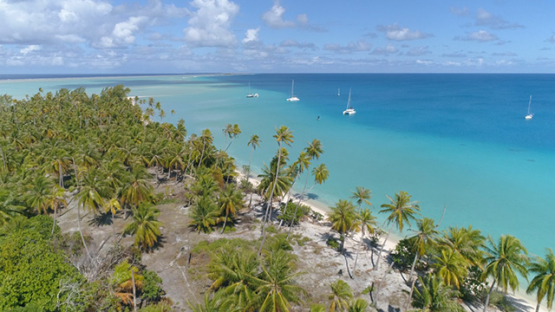 Fakarava, aerial view of sail boats moored in the lagoon, 4K UHD