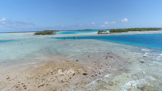 Rangiroa, aerial view of the blue lagoon, islets and boats of tourists, 4K UHD