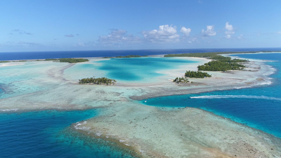 Rangiroa, aerial view of the blue lagoon, islets and barrier reef, 4K UHD