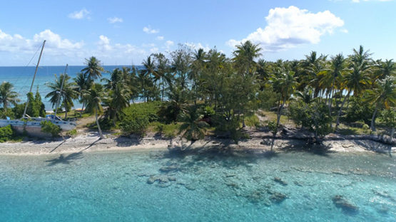 Rangiroa, aerial view of a sailboat beached on the islet in the pass Avatoru, 4K UHD
