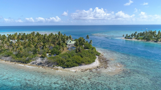 Rangiroa, aerial view of the private islet in the pass Avatoru, 4K UHD