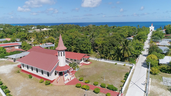 Rangiroa, aerial view of the village Avatoru and its church, 4K UHD