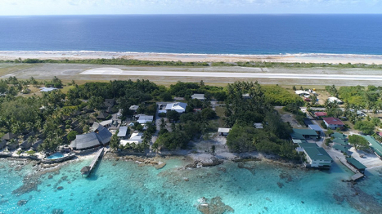 Rangiroa, aerial view of the airport and runway near the village, 4K UHD