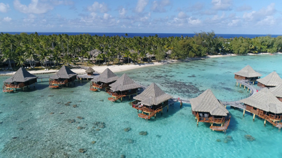 Rangiroa, aerial view of a luxury overwater hotel on the lagoon, 4K UHD