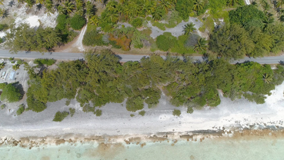Rangiroa, aerial view above the road near the barrier reef, 4K UHD