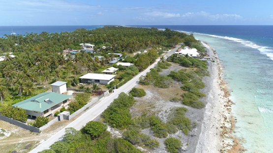 Rangiroa, aerial view of the road and dwellings near the barrier reef, 4K UHD