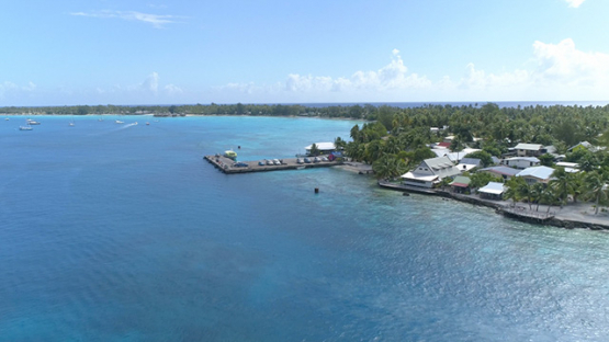 Rangiroa, aerial view of the dock of Tiputa pass, 4K UHD