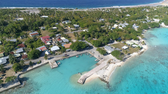 Rangiroa, aerial view of the village Tiputa and its marina, 4K UHD