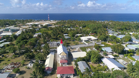 Rangiroa, aerial view of the village Tiputa and its church, 4K UHD