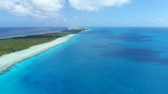 Rangiroa, aerial view of the lagoon along the barrier reef and islet, 4K UHD