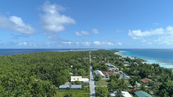 Tikehau, aerial view of the main street of the village Tuherahera, 4K UHD