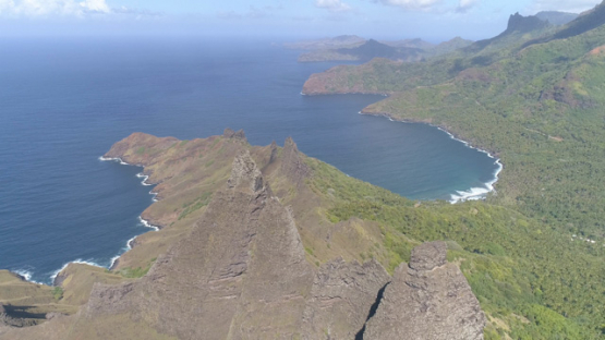 Nuku Hiva, aerial view of the coast of Aakapa and summit, 4K UHD