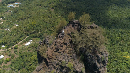 Nuku Hiva, aerial view of the valley Hatiheu and statue, 4K UHD