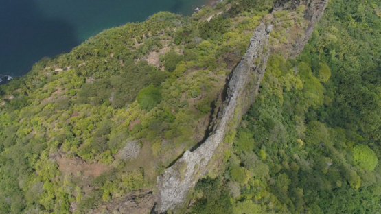 Nuku Hiva, aerial view above the rocky crest in the Hatiheu bay, 4K UHD