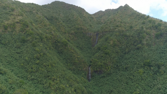 Nuku Hiva, aerial view of waterfall in the valley Hatiheu, 4K UHD