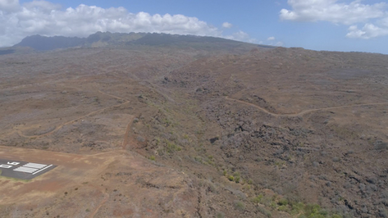 Nuku Hiva, aerial view of the desert land and airport, 4K UHD
