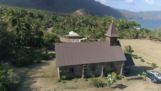 Hiva Oa, aerial view of the church in the valley Taaoa, 4K UHD