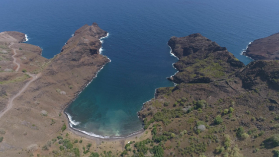 Hiva Oa, aerial view above the rocky coast of Puamau, 4K UHD