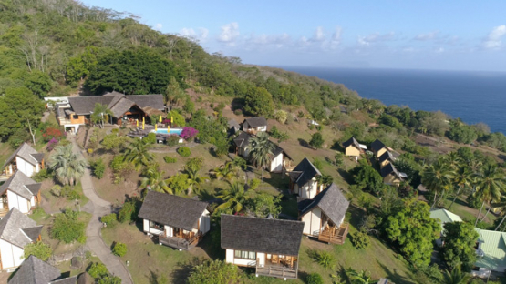 Hiva Oa, aerial view of an hotel and bungalows of Atuona, 4K UHD