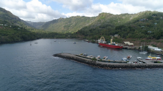 Hiva Oa, aerial view of the marina of Atuona and cargo ship, 4K UHD