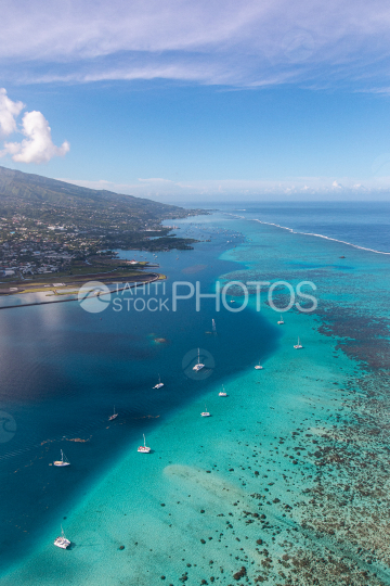 Tahiti, aerial photography of sailboats anchored in the lagoon of Faaa