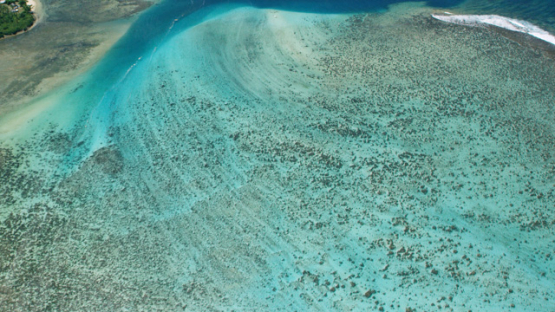 Aerial view of Moorea, west coast and barrier reef, 4K UHD