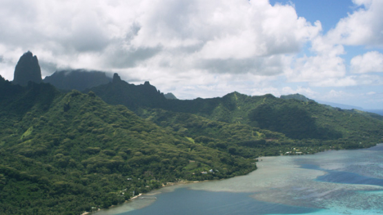 Aerial view of Moorea, west coast and barrier reef and mountain, 4K UHD